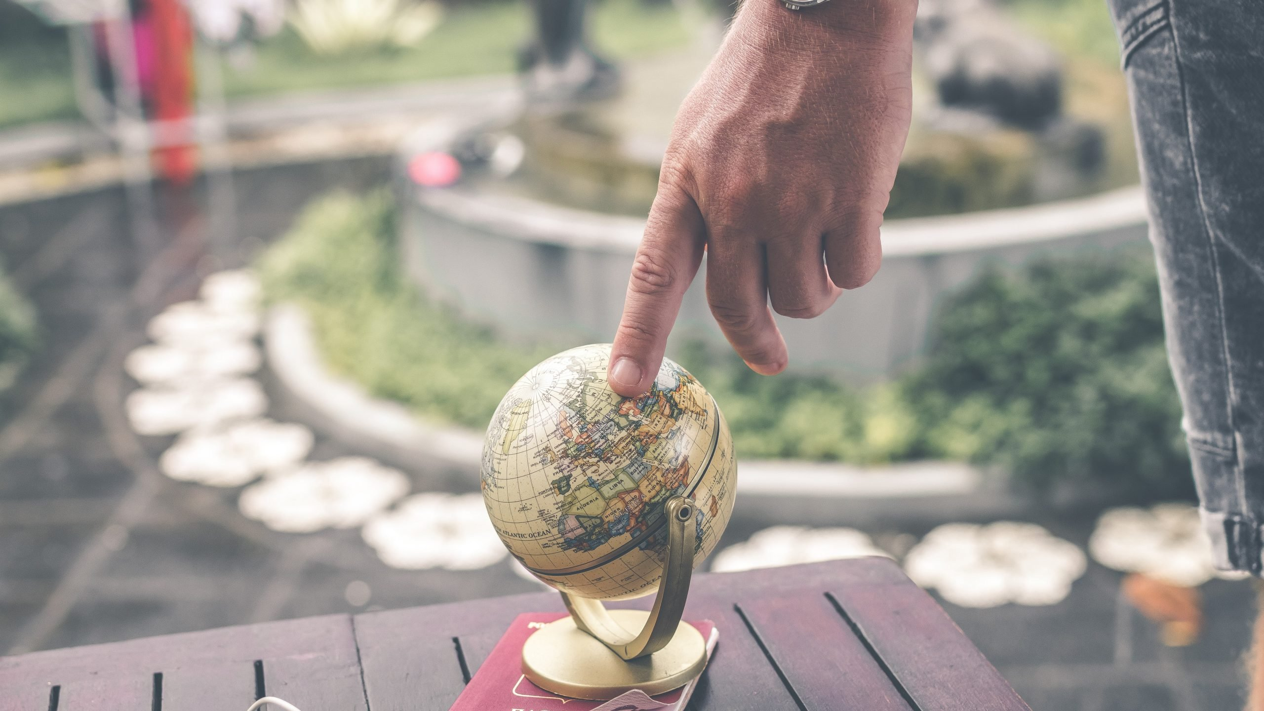 Person holding a globe scale model.